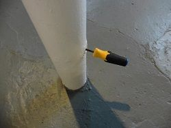 Basement support pole with a screwdriver that went right through the side, found by Keystone Home Inspection