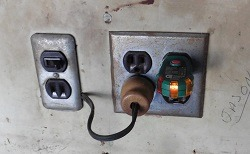 These outlets were found in a garage. 2 prong service, spliced exension cord wiring feeding a second outlet and 3 prong ungrounded.